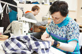 Female tailor at work — Stock Photo