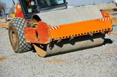 Heavy compactor roller at road work — Stock Photo