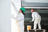 Plasterers at indoor wall work — Stock Photo