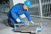 Tiler working with tile cutting equipment — Stock Photo