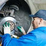 Auto mechanic at car suspension repairing — Stock Photo #57108131