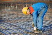 Builder making reinforcement for concrete — Stock Photo