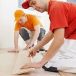 Parquet workers at flooring work — Stock Photo #57207467