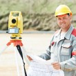 Surveyor works with theodolite — Stock Photo #57248673