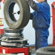 Car wheel lubrication during replacement — Stock Photo #57494475