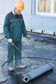 Flat roof covering repair works with roofing felt — Stock Photo