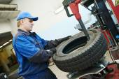 Car wheel tyre fitting or replacement — Stock Photo