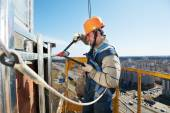 Worker builders at facade tile installation — Stock Photo