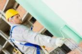 Builder facade painter at work — Stock Photo