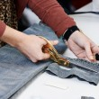 Female tailor hands at work — Stock Photo #57659341