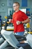 Cardio-fitness jogging at treadmill — Stock Photo