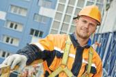 Builder at facade construction work — Stock Photo