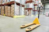 Hand pallet stacker truck at warehouse — Stock Photo