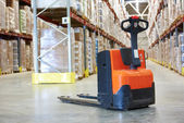 Pallet stacker truck at warehouse — Stock Photo