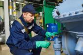 Service engineer worker at industrial compressor station — Stock Photo