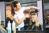 Hairdresser at work. Drying hair — Stock Photo