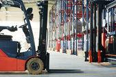 Forklift loader stacker truck at warehouse — Stock Photo