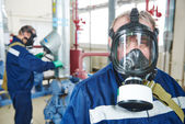 Service worker at industrial compressor station — Stock Photo