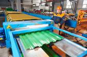 Worker at metal sheet profiling factory — Stock Photo