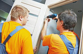 Door installation workers — Stock Photo