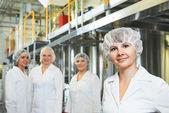 Pharmaceutical factory workers — Stock Photo