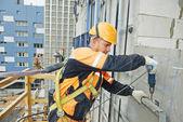 Builder at facade construction work — Stock Photo
