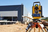 Surveyor equipment at construction site — Stock Photo