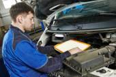 Car maintenance - air filter replacing — Stock Photo