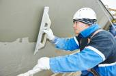 Worker at plastering facade work — Stock Photo