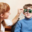 Eye examinations at ophthalmology clinic — Stock Photo #65475205