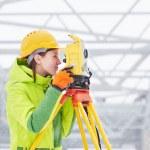 Surveyor works with theodolite — Stock Photo #65724725