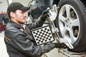 Car wheel alignment service work — Stock Photo