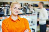 Selles assistant in shop — Stock Photo