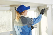 Plasterer at indoor wall work — Stock Photo