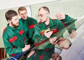 Windscreen repairman workers — Stock Photo