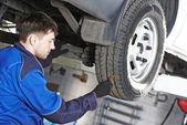 Car wheel protector measurement — Stock Photo
