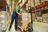 Warehouse female worker at work — Stock Photo