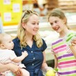 Woman and little girl shopping fruits — Stock Photo #67747361