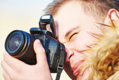Photographer at work outdoors — Stock Photo