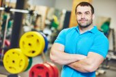 Male fitness trainer at gym — Stock Photo