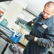 Mechanic checking oil level in automobile — Stock Photo #67756569