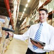 Manager in warehouse — Stock Photo #67756771