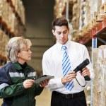 Warehouse crew at work — Stock Photo #67917339