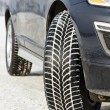 Winter tyres wheels installed on suv car outdoors — Stock Photo #67917375