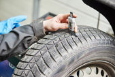 Car wheel protector measurement — Stock Photo
