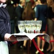 Waiter with tray and wine glasses at party — Stock Photo #68410653