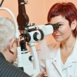 Female ophthalmologist or optometrist at work — Stock Photo #68410677