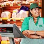 Female seller in supermarket shop — Stock Photo #69659129