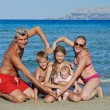Family at sea shore beach — Stock Photo #69769229