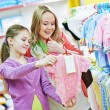 Woman and girl shopping clothes — Stock Photo #71023467